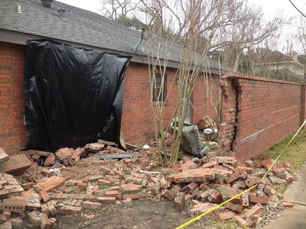 Bellaire home: Outside wall after SUV accident