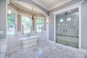 houston large-luxury-bathroom-with-white-subway-tile-and-black-accent-shower